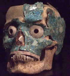 Turquoise mosaic encrusted and modified skull. 16th C. Olmec funeral mask.