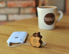 Wooden Apple Speaker by Motz for iPhone, iPod, iPad Made of wood and 100% handicraft products, this Tiny Wooden Apple speaker produces rich sound. Includes a USB connector for charging and a standard jack to connect to audio sources. Wannnaaaa