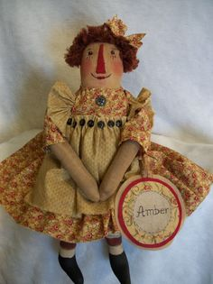 "Primitive doll ""PATTERN"" Raggedy Ann~ 21 in.~ Amber~by~ Dumplinragamuffin ~ Amber ~ Raggedy Ann 21 in ~ This is a Dumplinragamuffin original design made by me and will be signed and dated. You will get the pattern for Amber and her identity tag. She is made with distressed osnaburg fabric. Her facial features are stitched and I include instructions and diagrams for you to follow. Her hair is stitched to her head. Her dress is simple in design and she has painted on shoes and painted…"