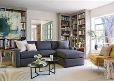 Living Spaces: Hide Away charcoal sectional and taupe bookshelves