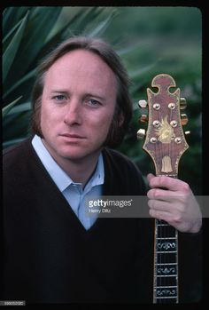 Folk-rock singer Stephen Stills rests in a garden. Stills became well-known in Buffalo Springfield, then moved on to Crosby, Stills, and Nash. CSN collaborated with Neil Young occasionally, and racked up many hits in the sixties and seventies.