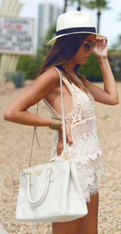 light and fun, perfect for gilis -  crochet dress, panama hat, white shoulder bag to match.