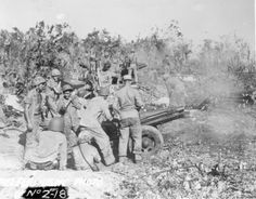 USMC 75-mm pack howitzer and crew, Peleliu, Palau Islands, Sep 1944