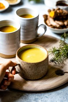 Learn how to make Turmeric Golden Milk: Made with turmeric, almond milk, cinnamon and ginger this is an easy Ayurvedic drink recipe that offers a ton of healing properties. Turmeric Milk Tea, Turmeric Golden Milk, Fresh Turmeric Root, Turmeric Paste, Turmeric Spice, Turmeric Recipes, Turmeric Detox, Ayurvedic Recipes, Organic Turmeric