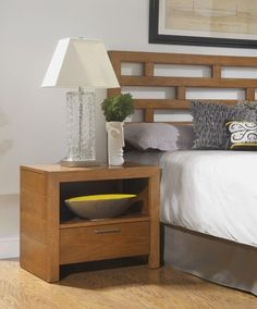 The versatile cherry finished Bainbridge nightstand has a miter frame front and sunken drawer, with a convenient storage shelf for reading materials and other items. A single bottom drawer with a silver bar pull provides extra hidden storage space. Rent a pair of Bainbridge nightstands to go with your existing bedroom décor or as part of the elegant Bainbridge bedroom furniture collection.