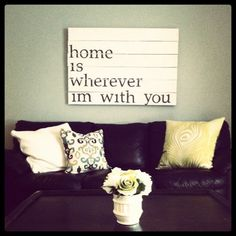 "wooden pallet sign with quote ""home is wherever i'm with you"""