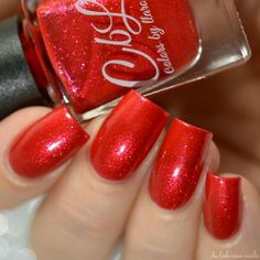 Colors by llarowe Holiday 2016 Collection - Ornamental is a bright Christmas red crelly base with red and gold glass fleck shimmer. Swatch by @delishiousnails.