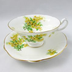 Heathcote bone china tea cup and saucer, white with yellow flowers. Gold trimming on cup and saucer edges. Excellent Condition (see photos). Markings read: Heathcote Bone China Made in England Please bear in mind that these are vintage items and there may be small imperfections from