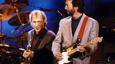 """Worlds Collide When Eric Clapton And Mark Knopfler Join Forces For """"Cocaine,"""" """"Sultans Of Swing"""" 