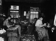 c. 1890: Men and women make neckties inside a tenement on Division Street in Little Italy. Image: Jacob A. Riis/Museum of the City of New York