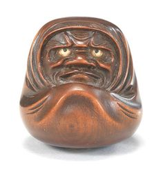 A wood netsuke of Daruma 19th century