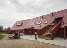 This bright red youth centre in Denmark is coloured to match the fishing cabins of the surrounding village #Architecture