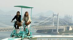 Japan's SkyCycle coaster suspends riders on thin rails, and they have to pedal the carts themselves.