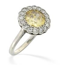 A yellow diamond cluster ring