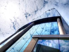 Cloud reflections in glass face of West Tower, Liverpool.