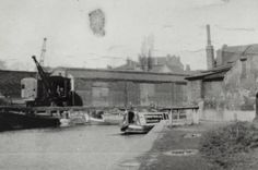 BW192-3-2-2-13-1-491Harvey-Taylor motor at Brentford on the Grand Union Canal Description Black and white photograph showing the boat moored on the canal below Brentford Lock. There are Fellows, Morton & Clayton Limited narrowboats and a rail mounted crane on the opposite side of the canal. Date c1935
