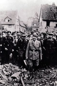 Adolf Hitler examines wreckage in an undated German photo captured by the U.S. Army on the Western front. For the first and only time since the Germans overran Paris four years earlier, the Führer in mid-June of 1944 would return to France to confer with his commanders in Margival about the Allied invasion.