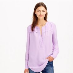 """{J.Crew} Covered-button crepe blouse Easily one of most versatile pieces in your closet, thanks to the clean lines, drapey fabric and easy tunic fit.  Viscose. Long sleeves. Functional buttons at cuffs. Popover hidden placket. Dry clean. Import. Item A9993. Retail. $98 Body length: 30"""". Worn Once has a couple of snags (not noticeable) as pictured. Modeled picture is true color. J. Crew Tops"""