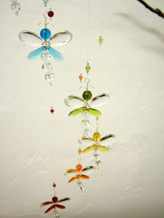 This whimsical rainbow dragonfly mobile has been hand crafted from Swarovski…