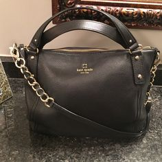 NWT Kate Spade large black satchel/ cross body bag weekend sale!! I absolutely adore this bag. But if you want to know the truth I had too many cocktails and was shopping online and I thought I had ordered a red one. I decided to keep it because it was so beautiful thinking I would eventually use it and yet I first took the inner packaging out just tonight to photograph it and decide to sell it! So this is brand spanking new ladies. Lovely gold hardware. Silky interior w/ zip pouch and 2…
