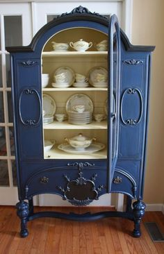 "The exterior is painted in Napoleon Blue with accents of Graphite. The interior is painted Cream (Annie Sloan Chalk Paint).""Painted Vintage China Cabinet, chalk paint"
