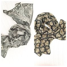 """Pair of oblong scarves Two black patterned scarves in a polyester crepe. The first is a black and white combo; the second black and beige. Each measures Approx. 13"""" by 53"""". Only worn a few times; fabric tags have been removed. Accessories Scarves & Wraps"""