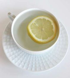 A mug of hot lemon water in the morning wakes up your digestive system and helps get things moving. ... - POPSUGAR Photography / Lizzie Fuhr