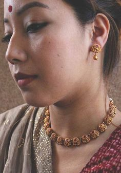 Items similar to Ruby Red Minimalist Gold Plated Temple work And Semi precious Stones Necklace Set With Gold Plated Earrings on Etsy Gold Temple Jewellery, Gold Jewellery Design, Indian Gold Jewelry, Bohemian Jewelry, Gold Mangalsutra Designs, Gold Earrings Designs, Short Necklace, Necklace Set, Gold Necklace
