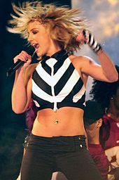 1990s Body piercing and/or tattooing. Britney Spears make showing off the midriff very popular in the nineties. She had a belly button ring, so everyone else got a belly button ring. With the grungy look of the time, I think people were more willing to permanently decorate their bodies with piercings and tattoos.
