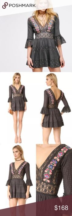 Free People Antiquity Mini Dress Boasting a true femme feel, this beautiful mini dress features lavish lace accents throughout, and gorgeous garden-inspired embroidered details. The defined waist adds a burst of confidence with every step, while the fabulous flared shape and brilliant bell sleeves mean that this must-have is sure to dazzle and delight any crowd. Approximately 33-in. L Zip closure V-neck Elbow bell sleeves Woven fabric Cotton, nylon Hand wash Imported  MSRP$168 Size:2 NWT…