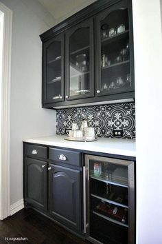 Butler Pantry Nook Is Filled With Glass Front Upper Cabinets And Ivory Lower Fitted A Beverage Fridge Paired Soapstone