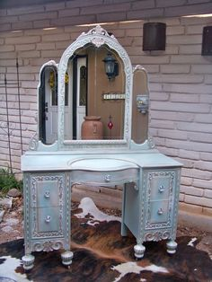 Always liked the idea of sitting down at a gorg vanity to put on makeup in the morning.