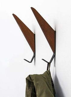 Swap out boot bench hooks. 16 stylish coat hooks that double as wall décor