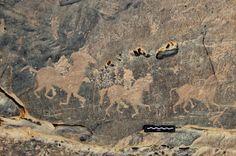 Engraved figures on horseback; riders defaced. Acacus mountains, Libya. © David Coulson/TARA
