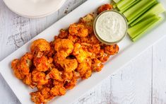 Looking for a healthy game day snack? Try these buffalo cauliflower wings with a creamy cashew dressing. They're absolutely delicious and easy to whip up. Vegan and gluten-free.
