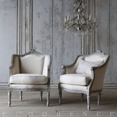 Eloquence, Inc. Pair of Vintage Bergeres: 1940 Stunning pair of bergeres in dusty gray finish with classical leaf carvings around the frame. 37H x 28W x 26D. Seat Height: 19. Arm Height: 25. Circa: 1940
