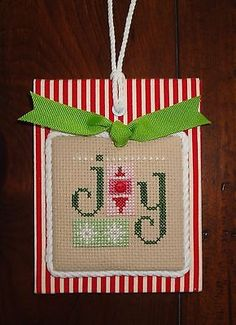 Details about finished completed cross stitch ornament LIZZIE KATE stitching forever finished completed cross stitch Christmas ornament Lizzie Kate JOY Tiny Cross Stitch, Xmas Cross Stitch, Cross Stitch Finishing, Cross Stitch Fabric, Counted Cross Stitch Patterns, Cross Stitching, Cross Stitch Embroidery, Cross Stitch Christmas Ornaments, Christmas Ornament Crafts