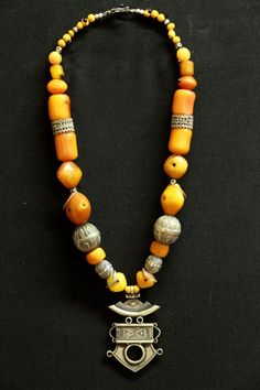 Antique Tuareg pendant made from Maria Teres thaler coins from Austria 18th c. Antique yemeni silver beads and rings, antique Mauritanian amber, silver from Indonesian, Tuareg nege nege. 24""