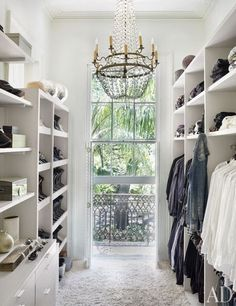 Absolutely beautiful walk-through closet. A Stunning Home Decorated in Black and White.
