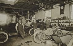 Model T Ford Forum: Old Photos - A Neat Old Time Repair Shops w/a Center-Door Sedan, Line-Shafting, a Harley-Davidson and a Speedster