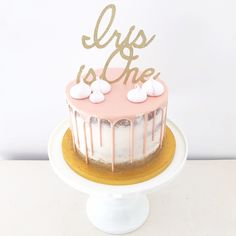 Pink drip first birthday cake with gold glitter by Blossom & Crumb