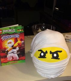 DIY! A Lego Ninjago Pumpkin made for my son's book project at school. We used acrylic paint and a t-shirt for his mask and tied behind to make it resemble theirs. Put plastic bags around pumpkin stem under shirt to shape head.