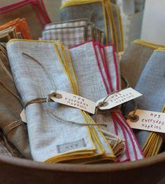 edge a natural linen napkin with a bright thread