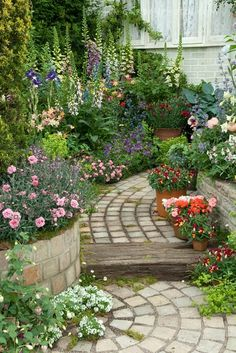 beautiful perennial flower garden with brick path