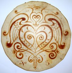 A drum very similar to a Celtic Bodhrán. A shamanic drum beautifully painted with Henna.