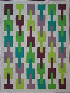 Designs to Share with You quilt pattern - Connected - designed by Ursula Riegel  Make a modern statement with this double-sided quilt.  Connected quilt pattern uses 2 yards of neutral grey or white and six half yard cuts for the big interlocking blocks and the binding. Included in the
