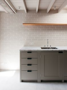 Thameside Townhouse Kitchen featuring handcrafted cabinets by Plain English with Carrara Marble worktops.  Island.    Blacksmiths Iron Handles.