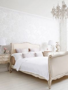 Choose reflective bedroom wallpaper to magnify the effect of a bigger and brighter light room!