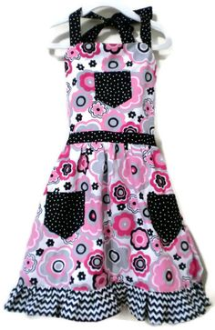 Any little girl will love to wear this cute retro daisy apron while helping Mom in the kitchen or baking in her own play kitchen!