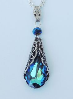 Vintage inspired 925 sterling silver necklace with Bermuda Blue Swarovski teardrop crystal wrapped in antique filigree. I think this would make a fabulous bridesmaid or mother of the bride gift. #bridesmaidsgifts